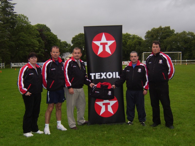 jerome presents tracksuits to mayo management